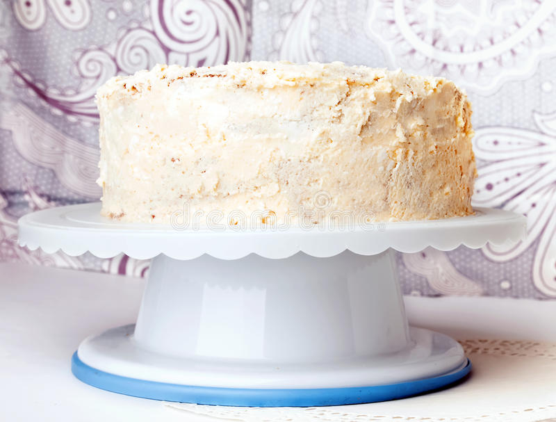 Cake with white buttercream frosting. Two layer apple cake with buttercream frosting royalty free stock photos