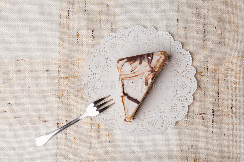 Cake with white chocolate. On cloth royalty free stock photography