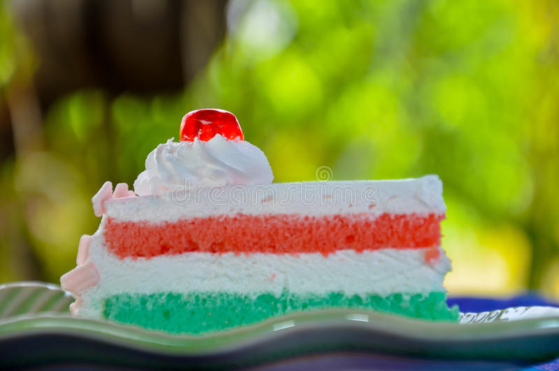 Cake with white cream and red jelly on top royalty free stock photography