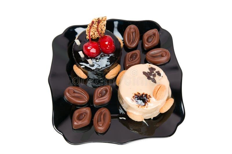 Cake with white and dark chocolate and chocolates