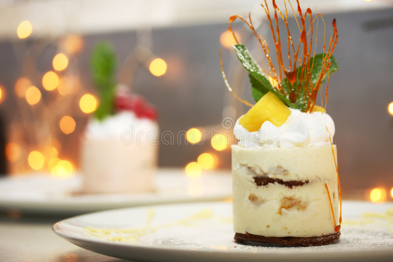 Cake with wood pineapples, sweet sauce and whipped royalty free stock photography