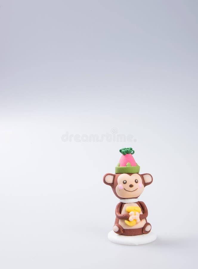 cakedecoratie of de eigengemaakte decoratie van de aapcake op een backgr royalty-vrije stock foto