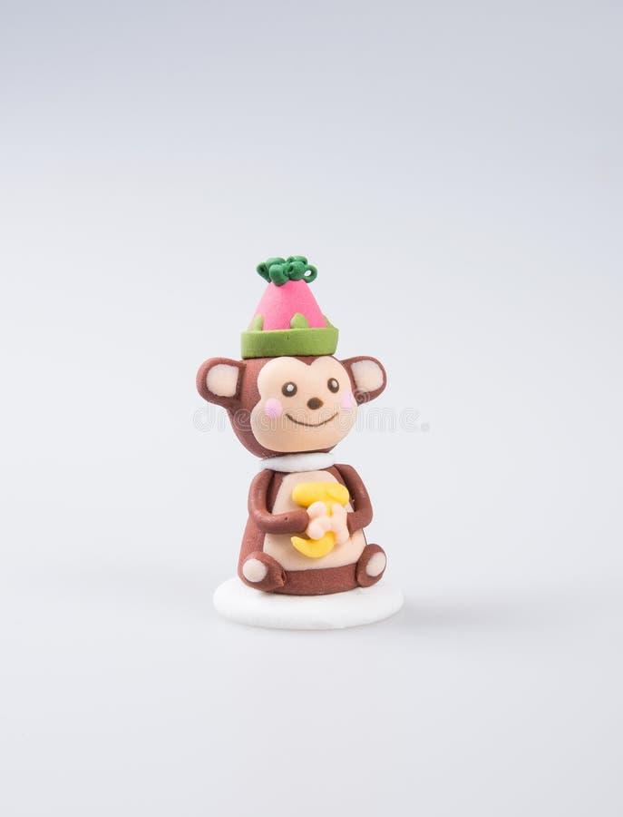 cakedecoratie of de eigengemaakte decoratie van de aapcake op een backgr royalty-vrije stock afbeeldingen