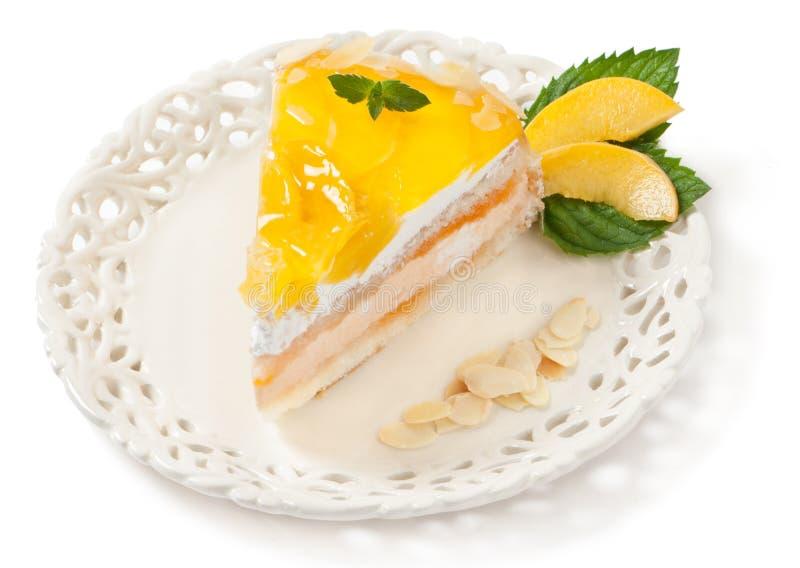 cakefruktpersika arkivbilder