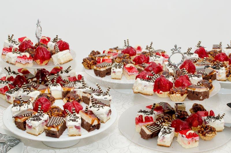 Cakes. Abundance of cakes on a table stock photos