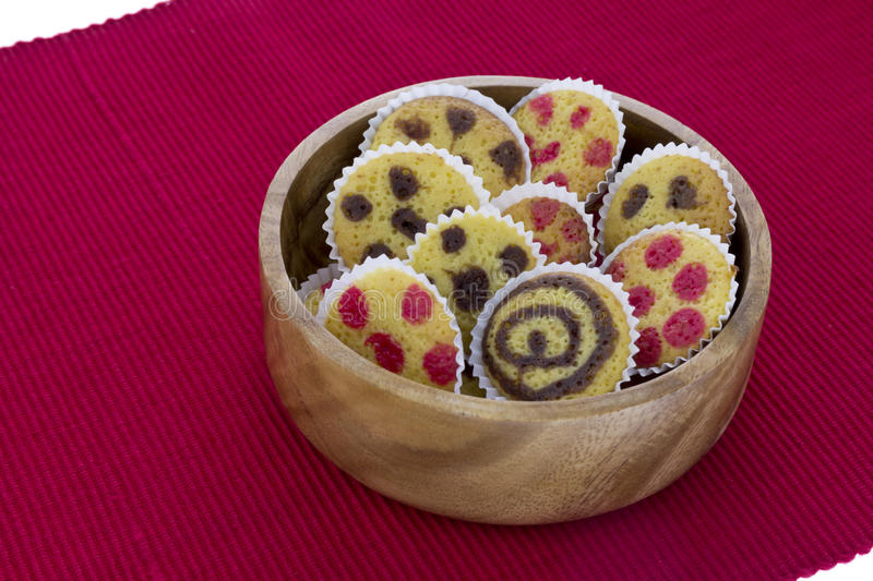 Cakes on a bowl over red towl stock photo