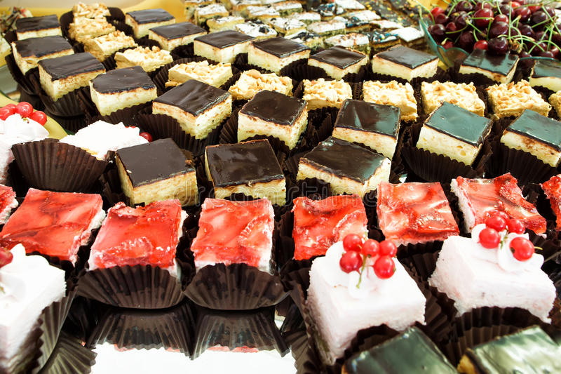 Cakes close up at dessert table at party. Shallow depht of field stock image