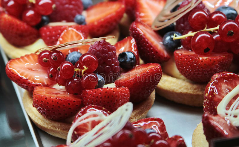 Cakes with cream and berries. Cakes with cream and fresh berries royalty free stock photography