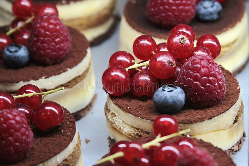Cakes with cream and berries. Cakes with cream and fresh berries stock photo