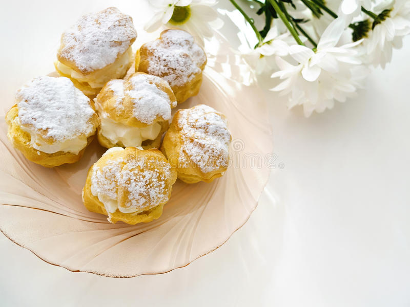 Cakes - cream puffs and eclairs royalty free stock image