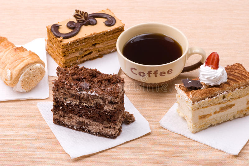 Cakes with cup of coffee stock images