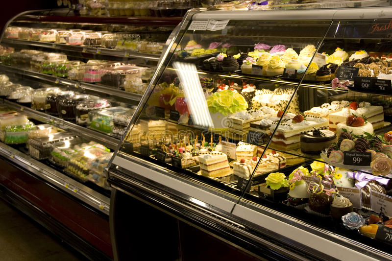 Cakes and desserts in supermarket. Many kinds of yummy and beautiful cakes and desserts in market stock photography