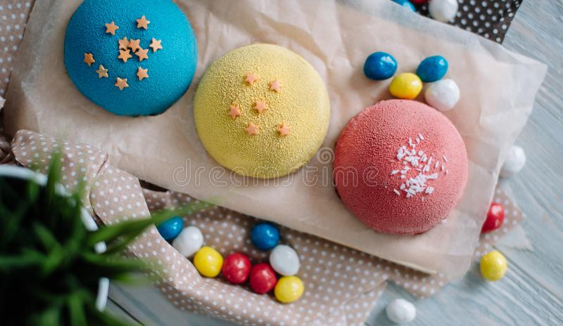 Cakes of different colors in still life royalty free stock photo