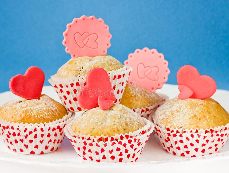 Cakes with fondant hearts. Sweet cakes with fondant hearts stock images