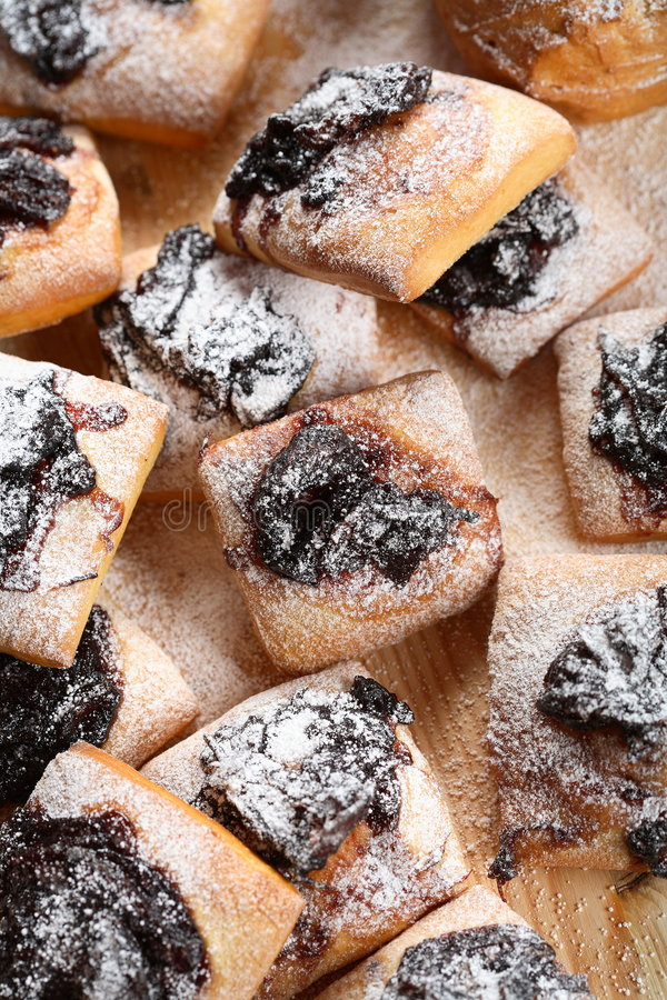 Cakes with jam and icing sugar. Delicious and sweet cakes with jam and icing sugar royalty free stock photography