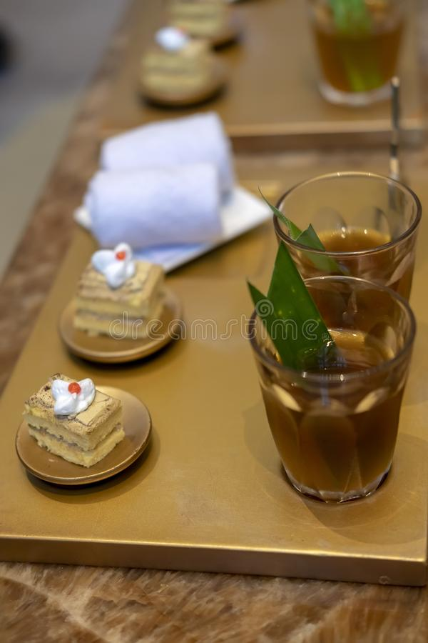 Cakes and Javanese traditional drink called jamu. stock photos
