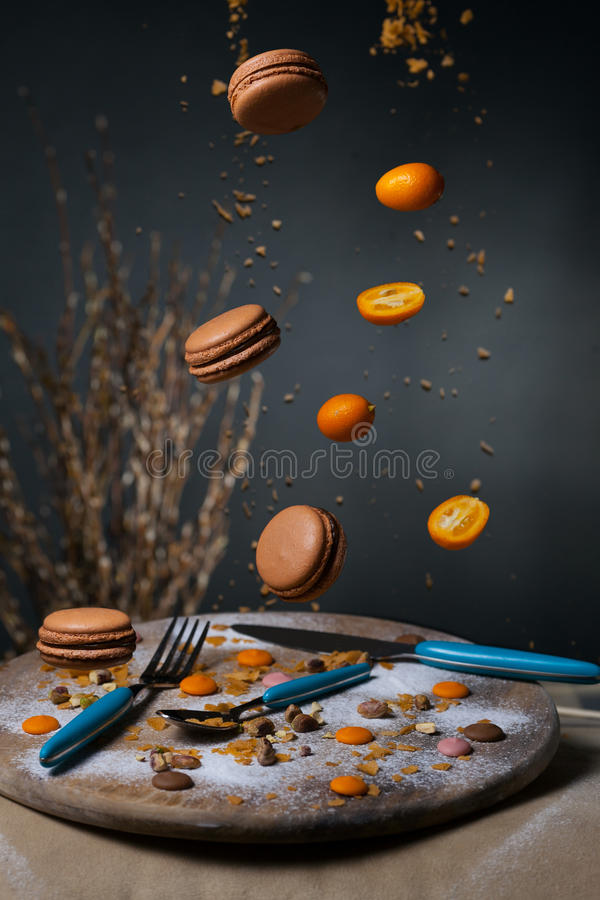Cakes, makaruns. Fall on a wooden tray royalty free stock images