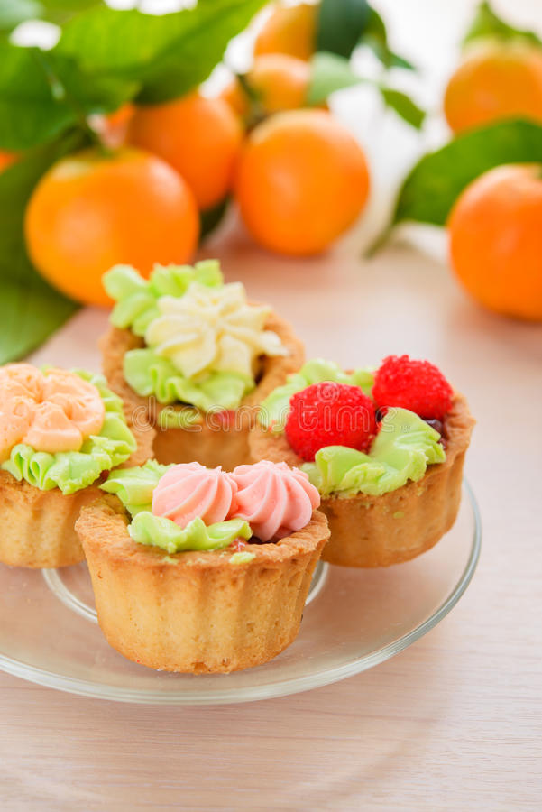 Download Cakes And Mandarins Royalty Free Stock Photo - Image: 33494835