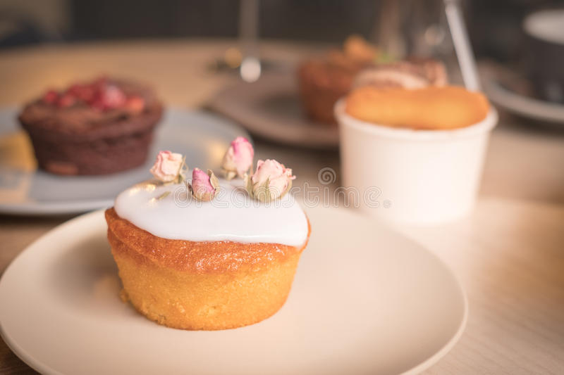 Cakes and pastries in the plates royalty free stock photo