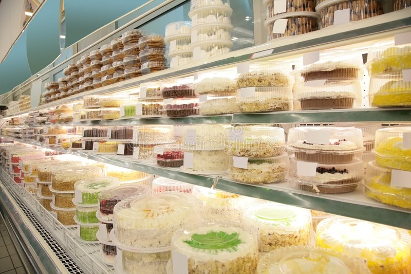 Cakes and pies in store stock photography