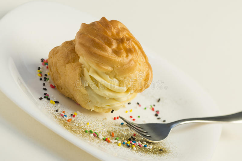 Cakes roll. Sweet roll cakes served on plate royalty free stock images
