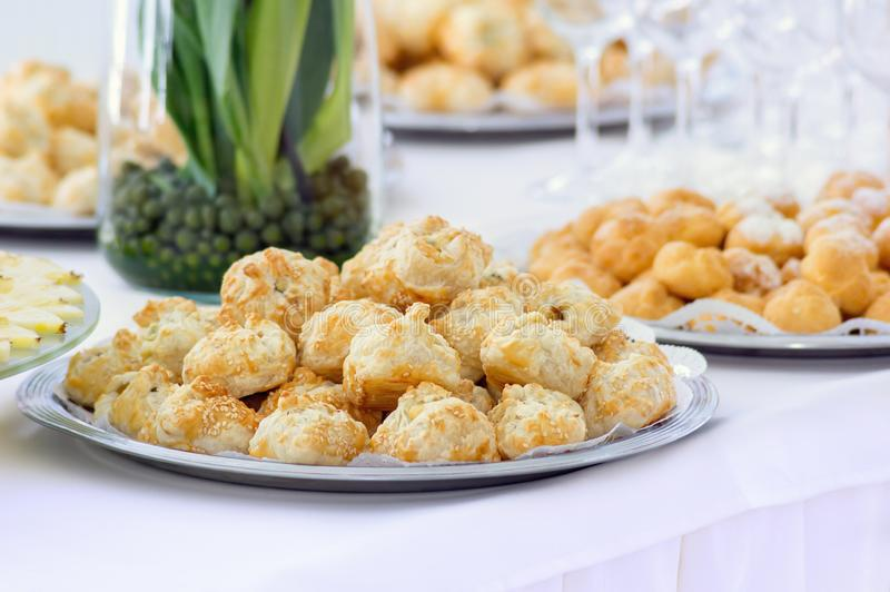 Cakes with sesame in a plate on a buffet table royalty free stock photography
