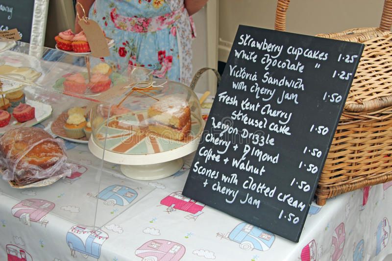 Cakes Stall And Price List. This photo shows cakes for sale and price list royalty free stock photos