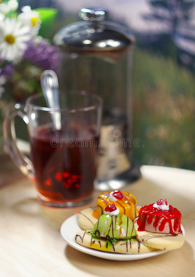 Cakes with tea stock image
