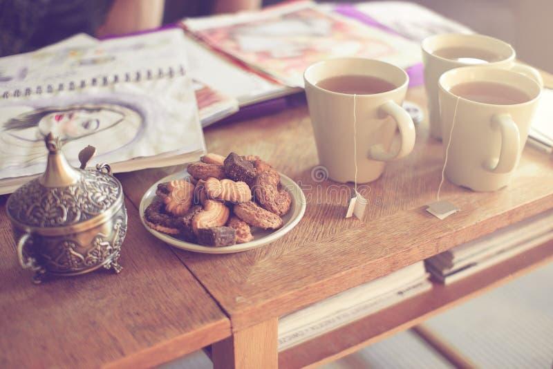 Cakes and tea stock photo