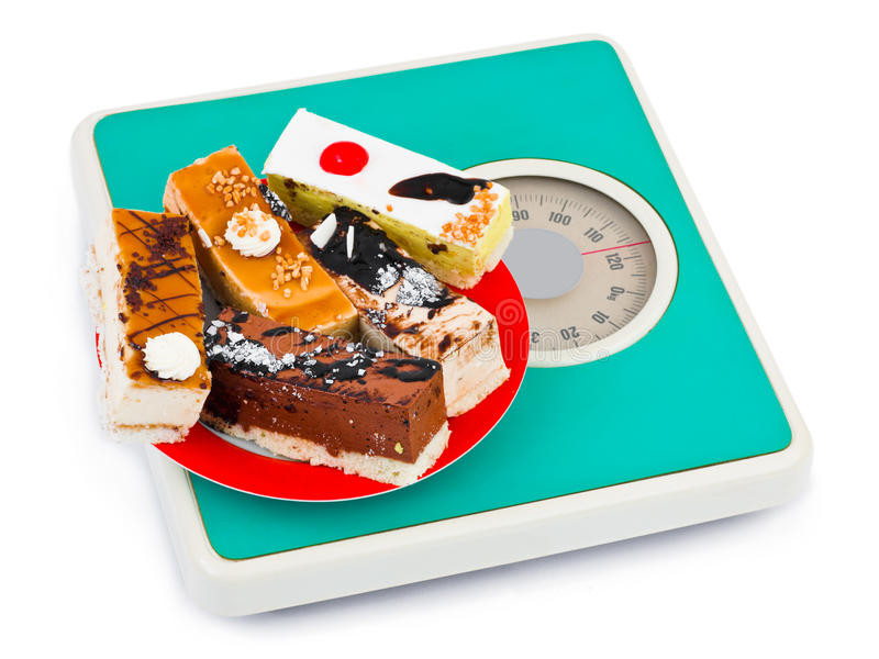 Cakes on weight scale stock photos