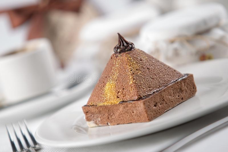 Cakes on a white plate, restaurant setting. Cream bakery pastry delicious food dessert chocolate closeup tasty slice sweet cafe cheesecake portion calories royalty free stock photo