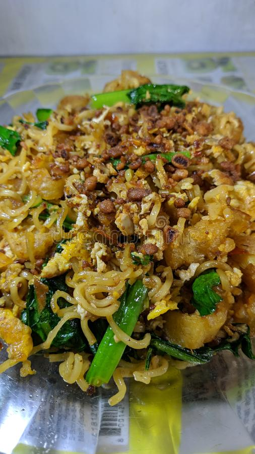 Cakwe Fried Noodles is a variety of instant fried noodle dishes in Indonesia royalty free stock photos