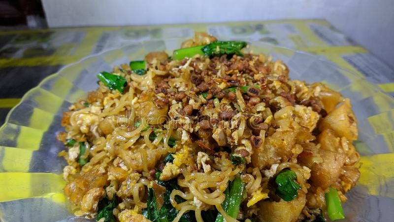 Cakwe Fried Noodles is a variety of instant fried noodle dishes in Indonesia stock image
