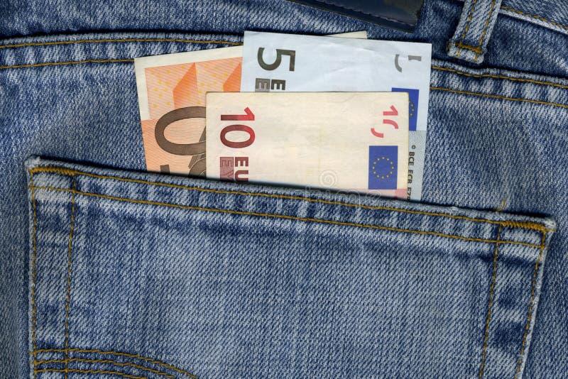 Calças com notas dos euro foto de stock