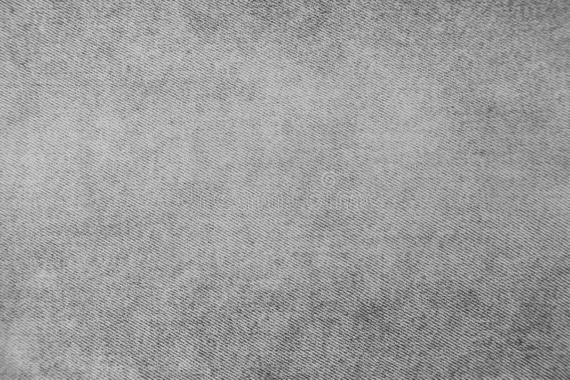 Calças de brim cinzentas da sarja de Nimes com fundo da textura das listras fotos de stock royalty free