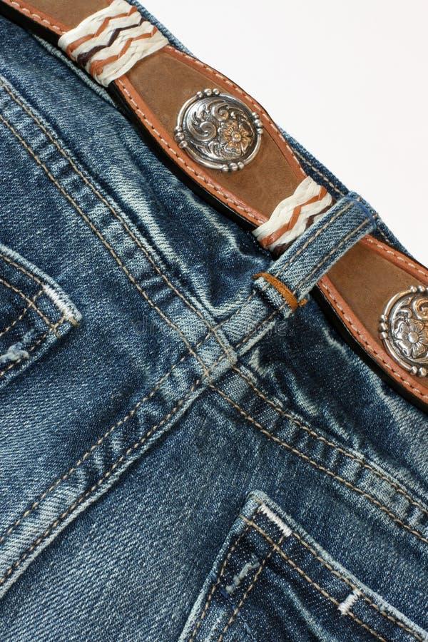 calças de brim com uma correia imagens de stock