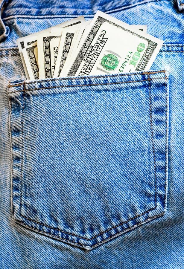 Calças de brim e dinheiro fotografia de stock