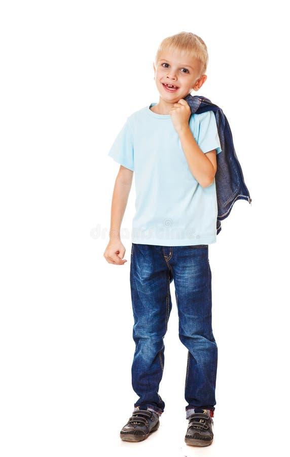 Calças de brim vestindo do menino foto de stock