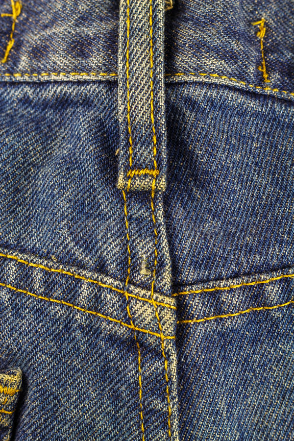 Calças de ganga com emenda, fundo da textura da sarja de Nimes, fim acima foto de stock