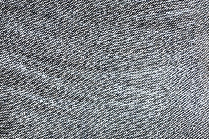 A calças de ganga enrugada fragmenta o tiro macro, textura abstrata foto de stock
