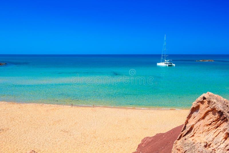 Cala del Pilar beach scenery on sunny summer day. Cala del Pilar beach scenery with white yacht on sunny summer day at Menorca, Spain royalty free stock photos