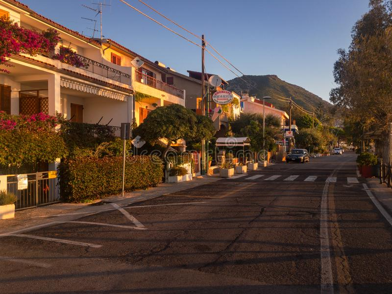 Seaside road Cala Gonone at sunrise royalty free stock image