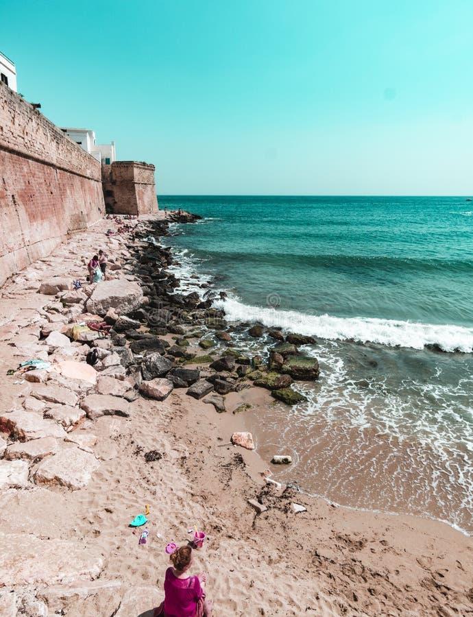 Cala Portavecchia with old walls on the left Monopoli - Puglia royalty free stock photo