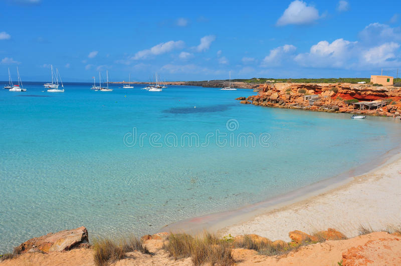 Cala Saona Beach in Formentera, Balearic Islands, Spain. View of Cala Saona Beach, the mediterranean Sea and the typical slipways and fishermen huts, called stock photos
