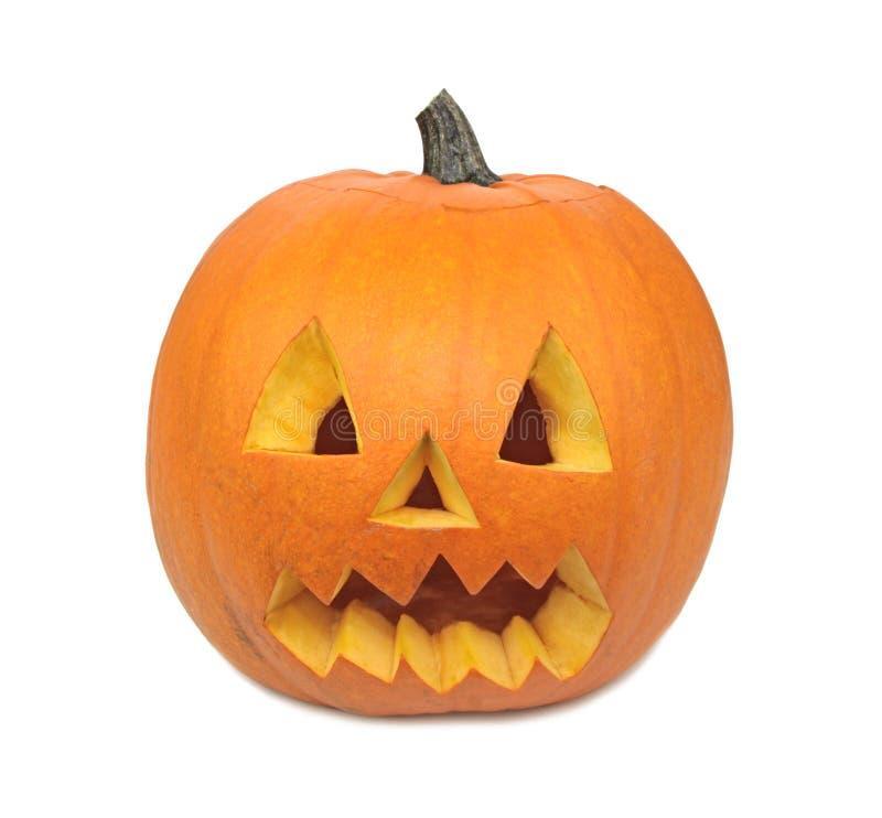 Calabaza de Halloween con la cara asustadiza aislada en el fondo blanco fotografía de archivo