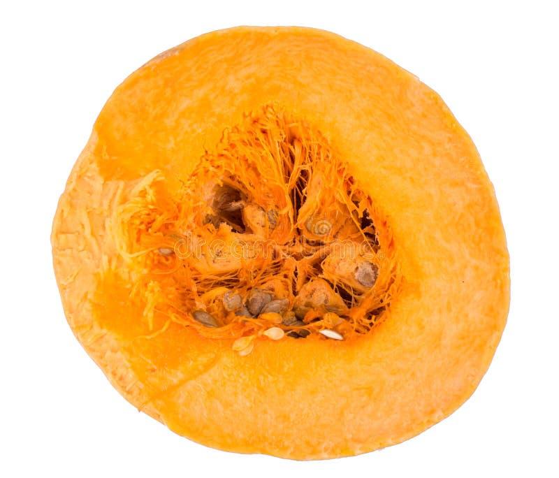 Calabaza a medias anaranjada con las semillas fotos de archivo