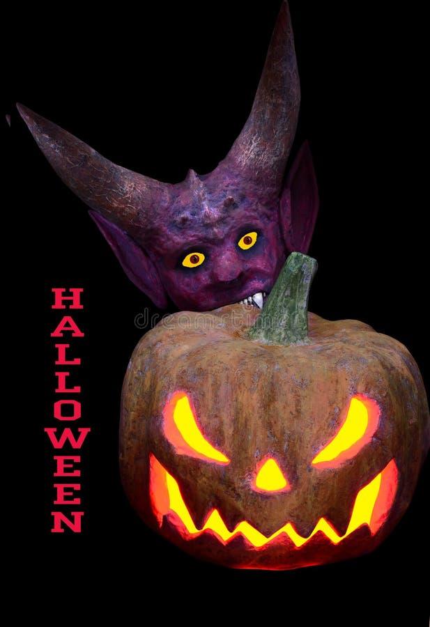 Calabaza y diablo asustadizos con los cuernos para Halloween fotografía de archivo