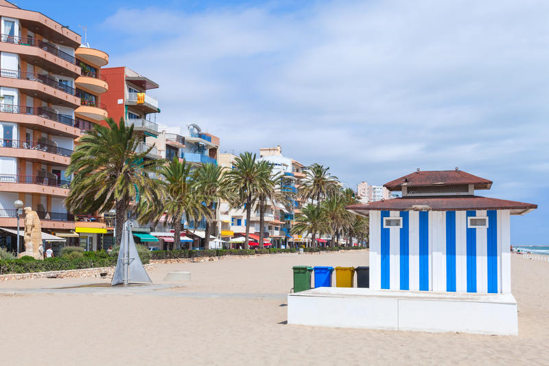 Calafell resort town in sunny summer day. Coastal street and wide public sandy beach of Calafell resort town in sunny summer day. Tarragona region, Catalonia stock images