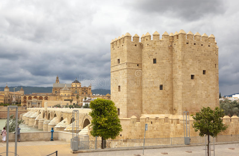Calahorra Tower and the Roman bridge. Cordova. Spain. Cordova, Spain - May 29, 2013: a stone arch bridge across the river on which people walk. On the opposite stock photos