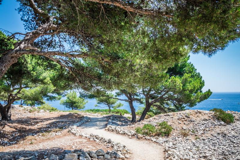Calanques near Cassis in a summer day. Cote d`Azur French Riviera is situated in the southern eastern part of the mediterranean coast of France and it is famous stock images